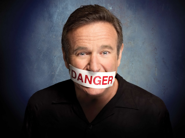 robbin williams with written danger on his mouth